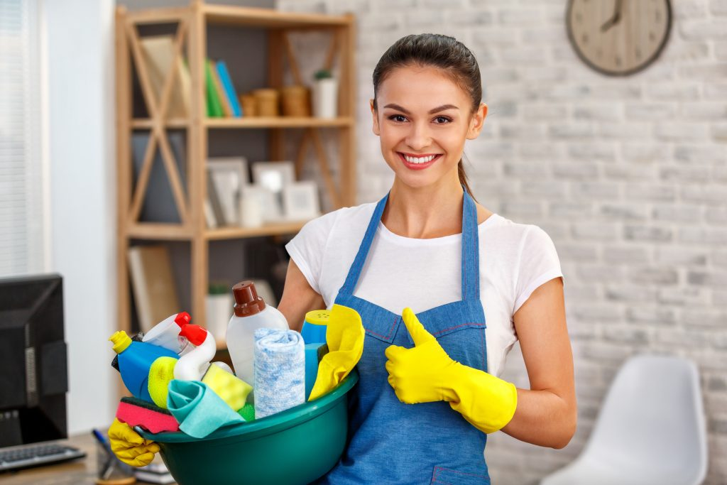 Housekeeper with cleaning supplies